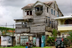 Colonial Ruins -seemingly abandoned homes line every street until you spot shadows of their inhabitants, Georgetown, Guyana -- Karina Noriega