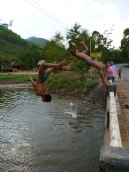 Young boys and girls leap off a bridge somewhere in Northern Laos - Karina Noriega