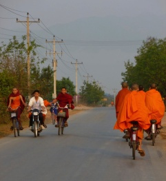 Numerous monks traffic the roads between villages, Laos - Karina Noriega