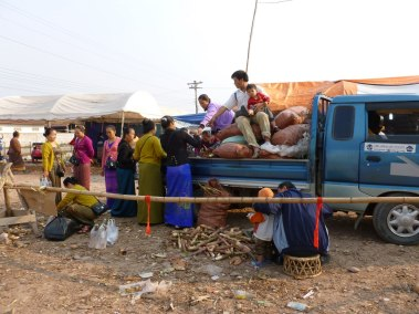 Unloading supplies at a local market, Laos - Karina Noriega