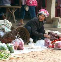 Local market woman, teeth stained blood red from chewing Betel nuts, Laos - Karina Noriega