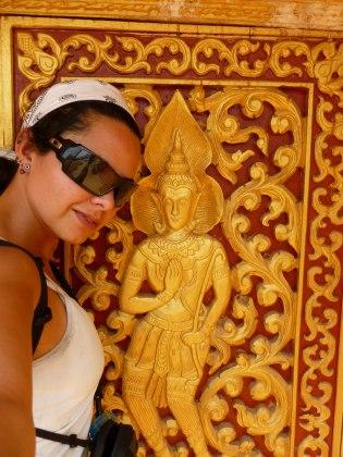 Golden Reliefs on a temple wall, Luang Nam Tha, Laos - Karina Noriega