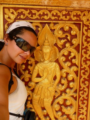 Golden Reliefs on a temple wall, Luang Nam Tha, Laos - Karina Noriega