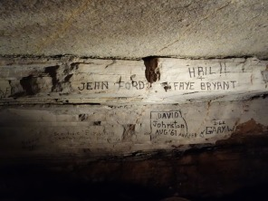 First explorers to this cave paint their names onto the rock face, Blanchard Springs Cavern, Arkansas - Karina Noriega