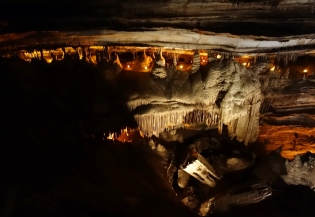Path of the original explorers (lighted) at Blanchard Springs Cavern, Arkansas - Karina Noriega