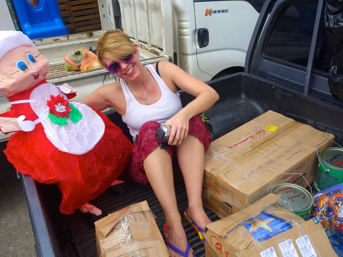 Riding in the back of truck with all the new supplies - Karina Noriega