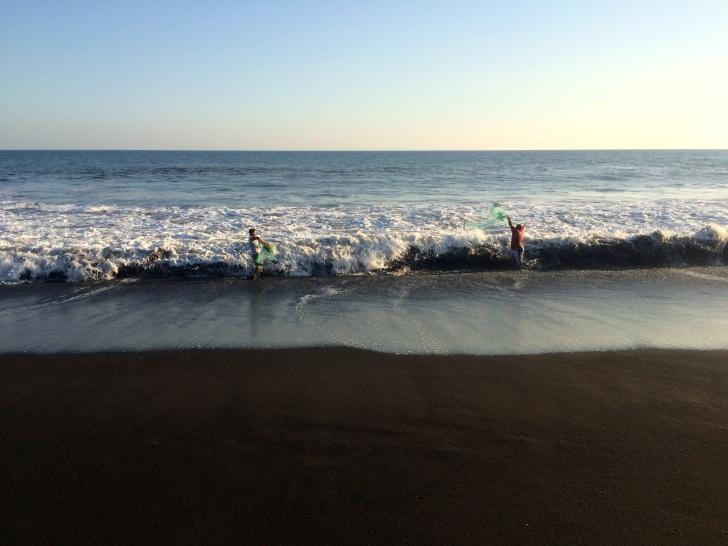 Fisherman throw nets over the Pacific waves -- Karina Noriega
