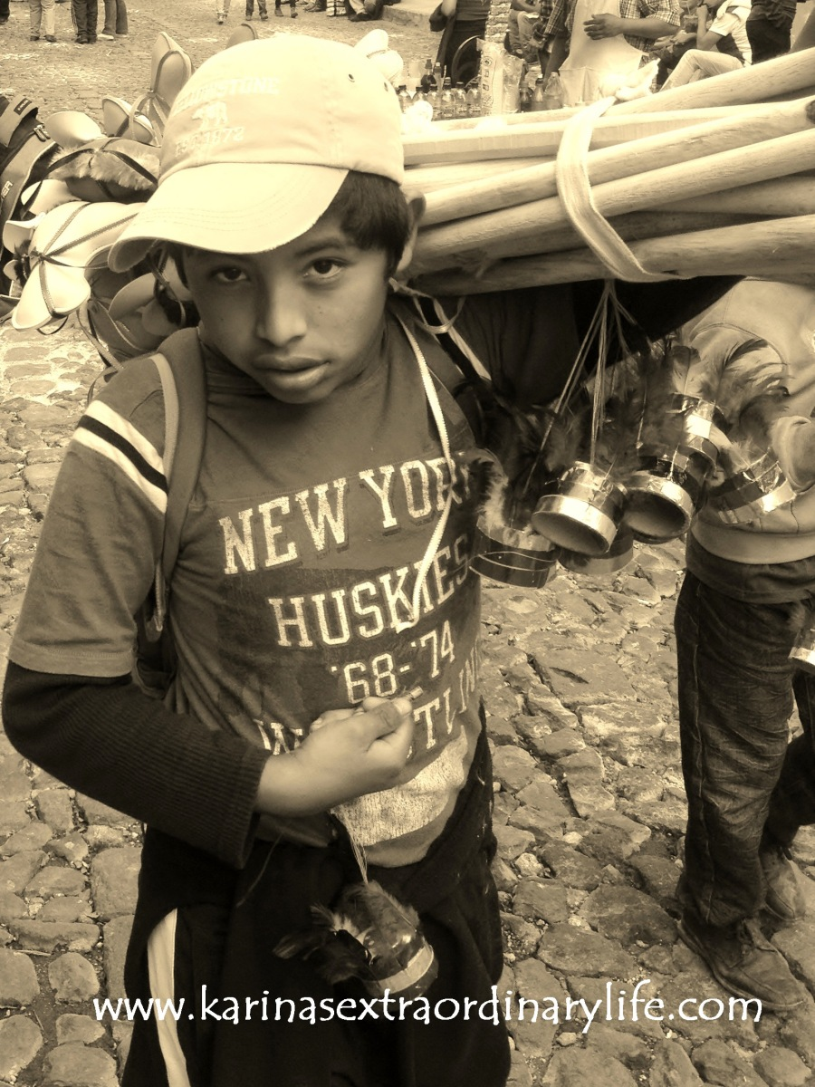 I noticed this little guy walking behind me as we followed the procession in the mid-day heat. Karina and I marvelled at his impressive strength, carrying such a large load for such a small person. Antigua, Guatemala -- April Beresford
