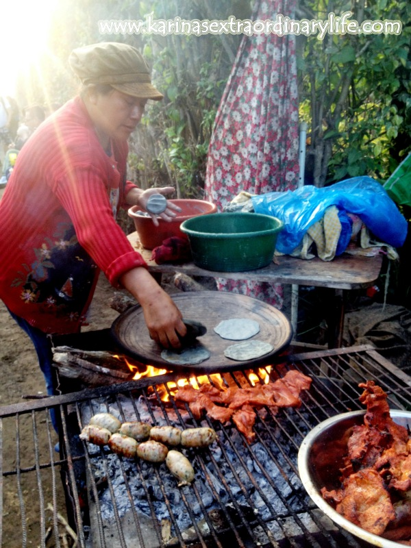 Local street vendor grills fresh meats on a makeshift roadside kitchen. Antigua, Guatemala -- April Beresford