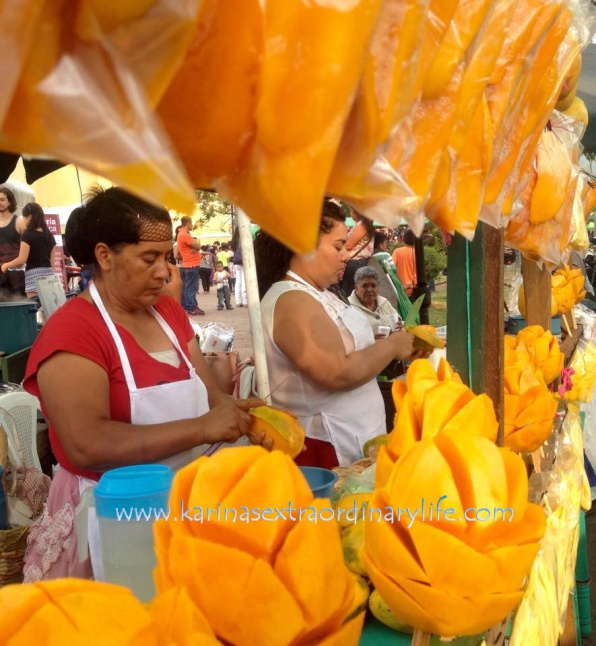 Mujeres preparing mangoes in a stand they set up in the street. Antigua, Guatemala -- April Beresford