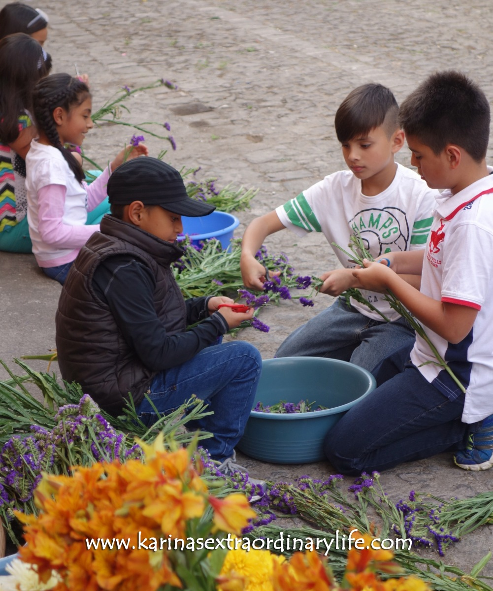 Second Graders cut the stems off the flowers for the alfombra collaboration. Antigua, Guatemala -- Karina Noriega