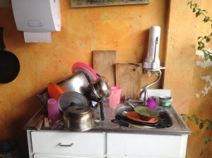 Messy Hostel Kitchen- Unfortunately when you are staying in a hostel, some patrons fail to clean up after themselves. Maid staff will clean up the mess when it bottlenecks but I encourage you to be a respectful traveler and clean up your own mess. Antigua, Guatemala -- April Beresford
