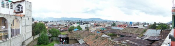 My bedroom in Xela was a concrete addition added on to the rooftop of the family home. When I stepped outside of my bedroom, this was the view overlooking the city. Xela, Guatemala -- April Beresford
