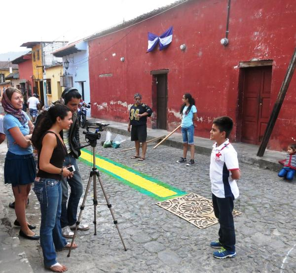 Karina, April and Alex document the childrens' stories during a collaborative project in Antigua, Guatemala. Photo by Kerstin Sabene