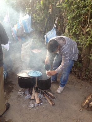 A young boy boiling water for coffee over open fire. Antigua, Guatmala -- April Beresford