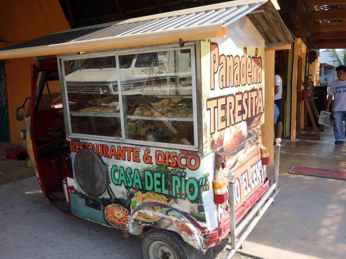 A 3-wheeled motorbike (tuktuk) converted into a mobile bakery. Rio Dulce, Guatemala -- Karina Noriega