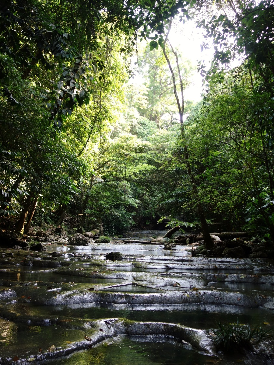 Follow the river through the jungle up to the waterfalls of Siete Altares, Guatemala -- Karina Noriega
