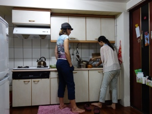 April (the apprentice), observing Chef Sharon as she strains random green veggy with no English name. The meal also consisted of duck blood rice, ground pork with onion and steamed rice. Taipei, Taiwan - Karina Noriega