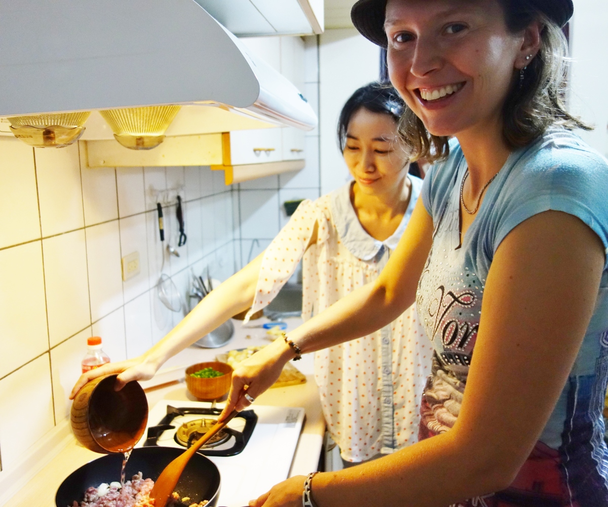 Our couchsurfing host Sharon teaching me how to prepare a delicious Taiwanese meal. I didn't burn a thing ! Taipei, Taiwan- Karina Noriega