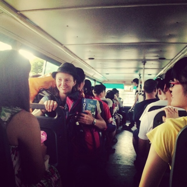 First time riding on a Chinese public bus. The whole system is made easier by curious locals eager to speak English and help us determine our stop. Guilin, Guanxi, China – Karina Noriega